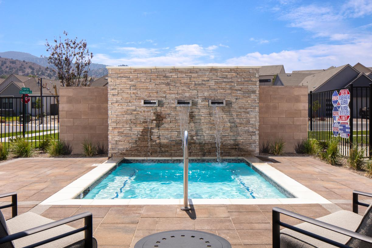 Relax in the outdoor spa and waterfall