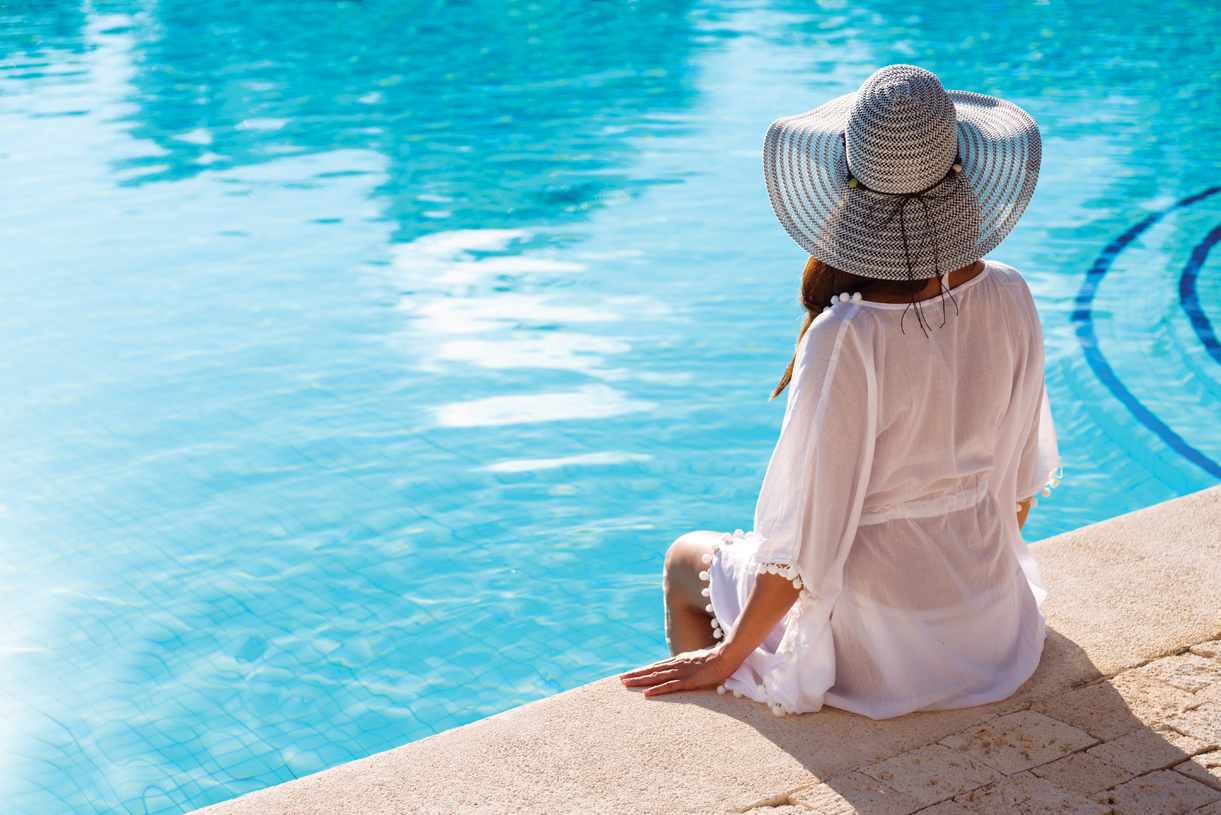 Relax poolside at the community outdoor swimming pool