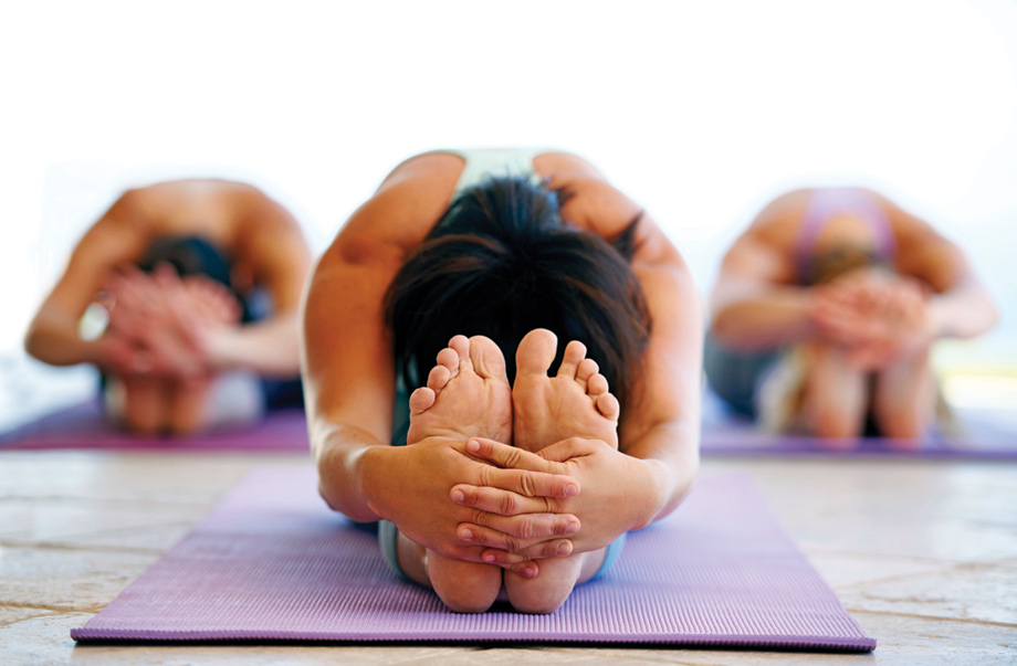 Do yoga at the community fitness center