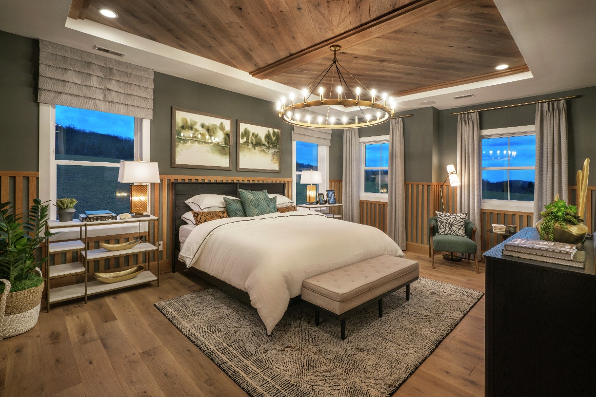 Luxurious primary bedroom suite with elegant primary bath and dual walk-in closets