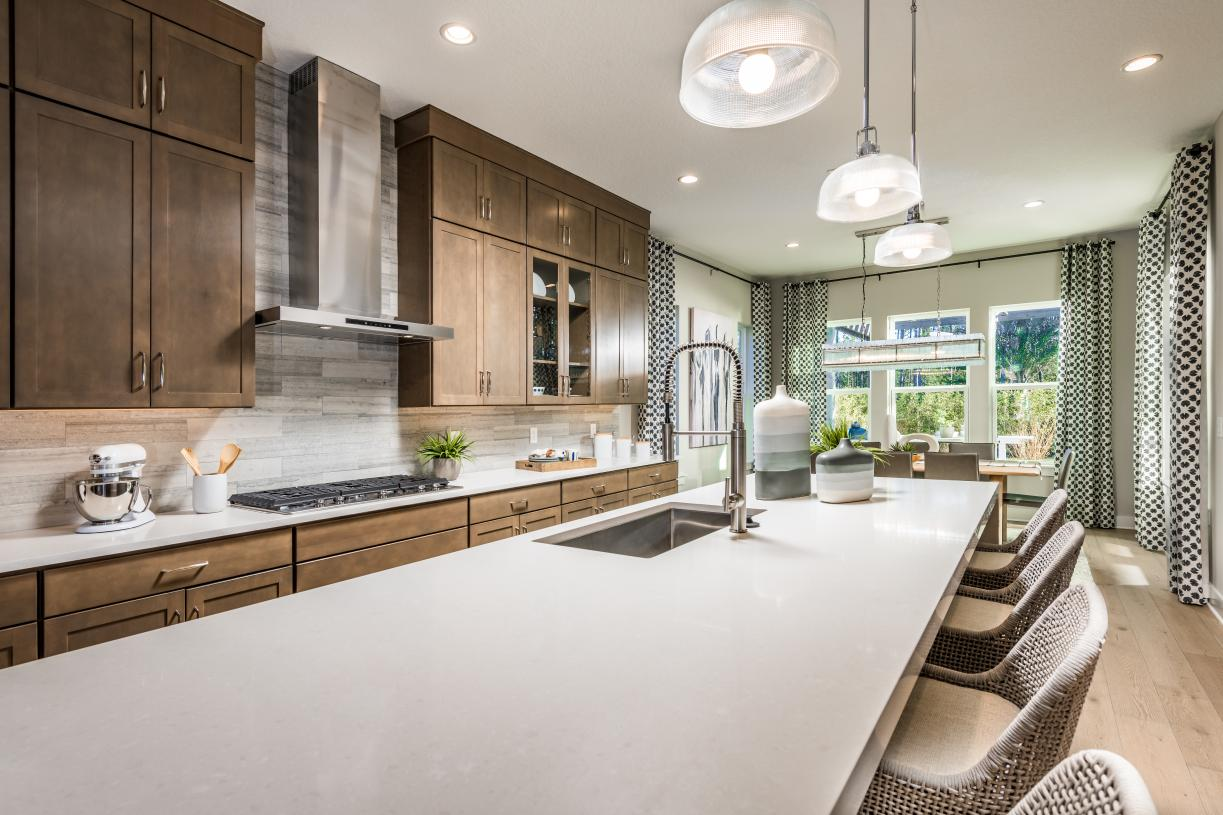 Large kitchen island open to casual dining area