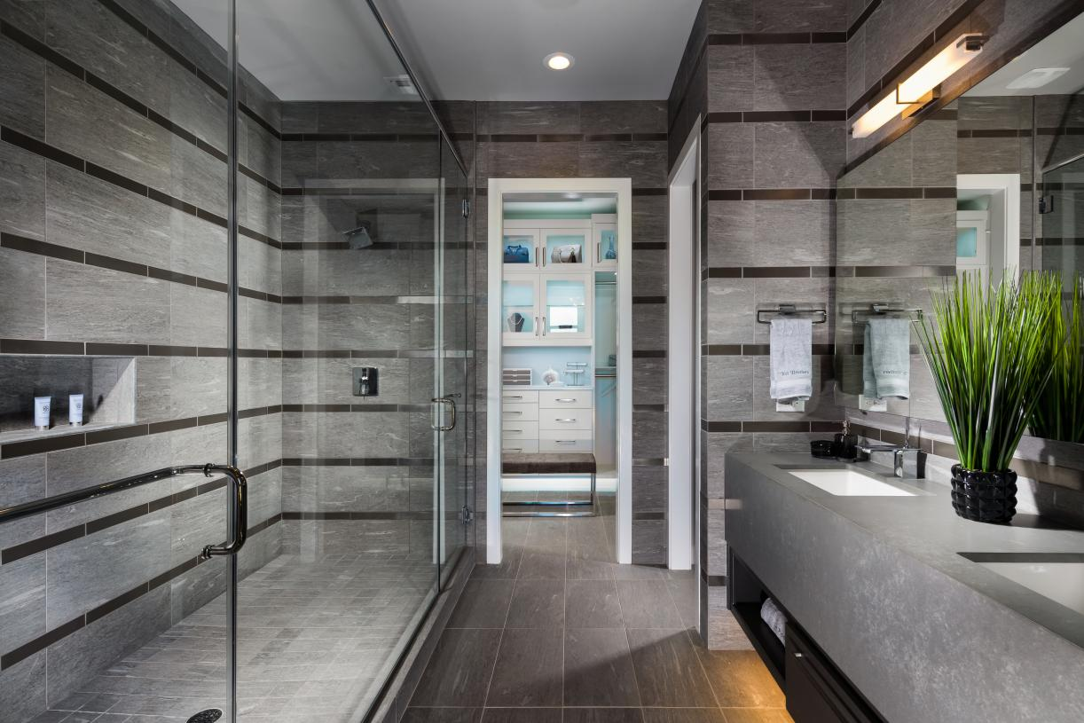 Spa-like primary bathrooms with dual-sink vanities and luxe walk-in showers
