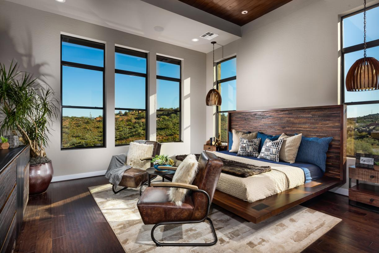 Spacious primary bedroom suites with mountain views