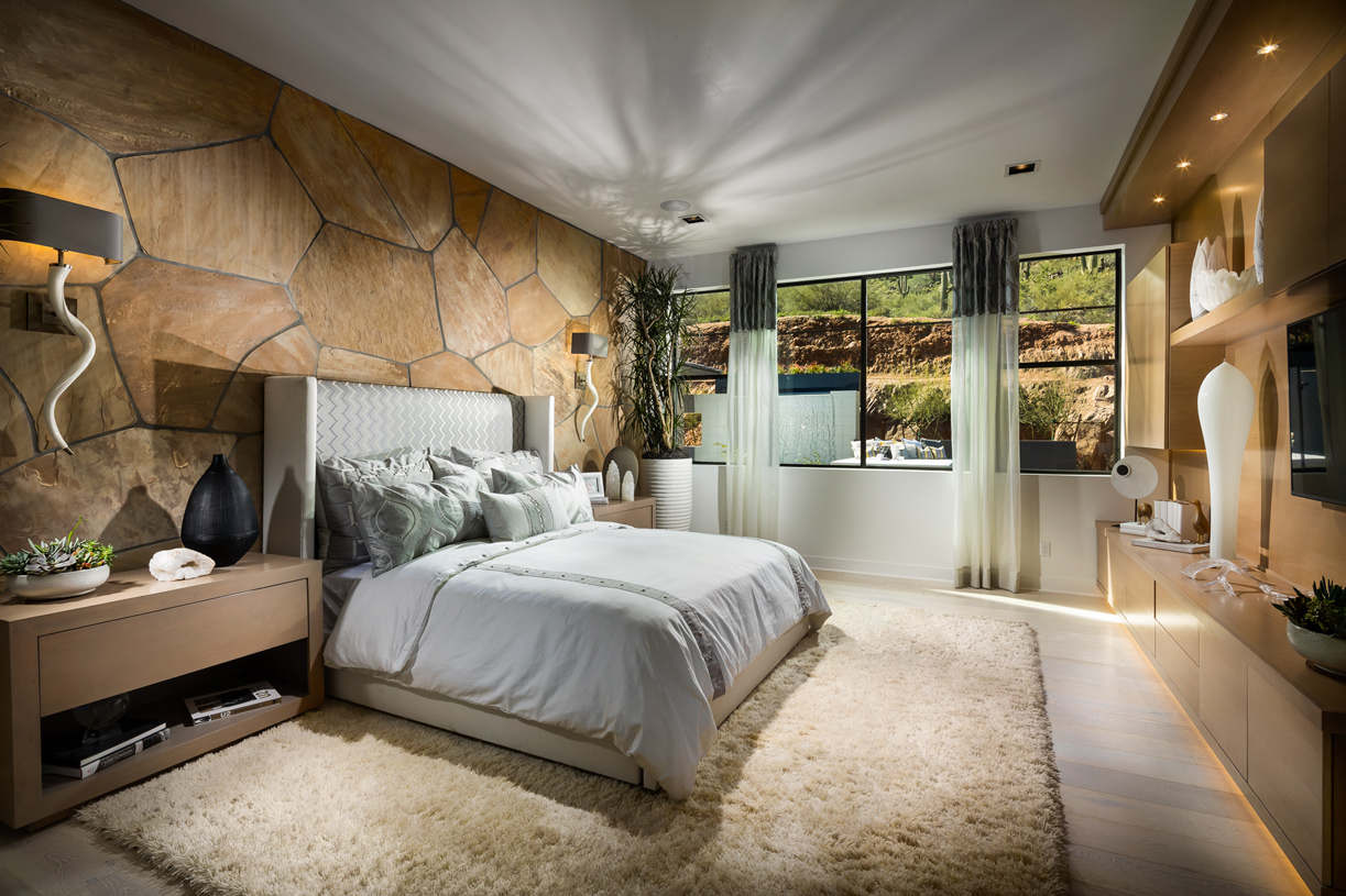 Palatial primary bedroom suites with mountain views