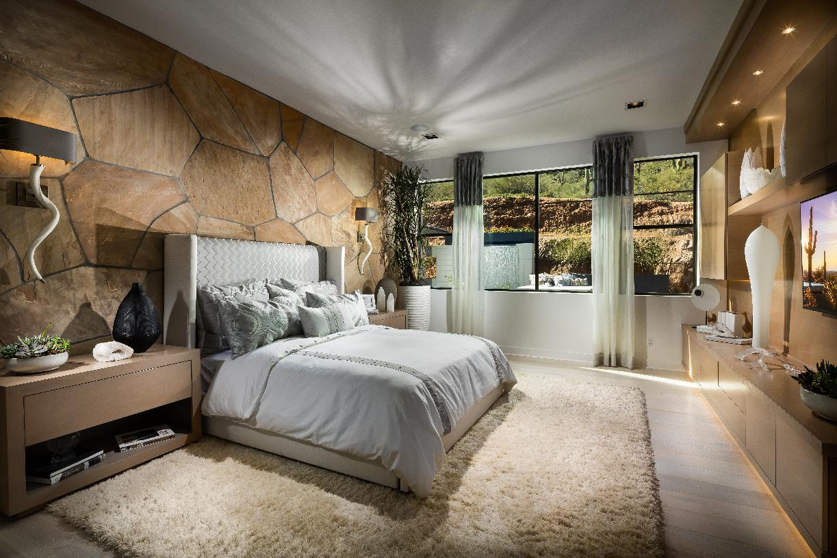 Private primary bedroom suite with lounge area