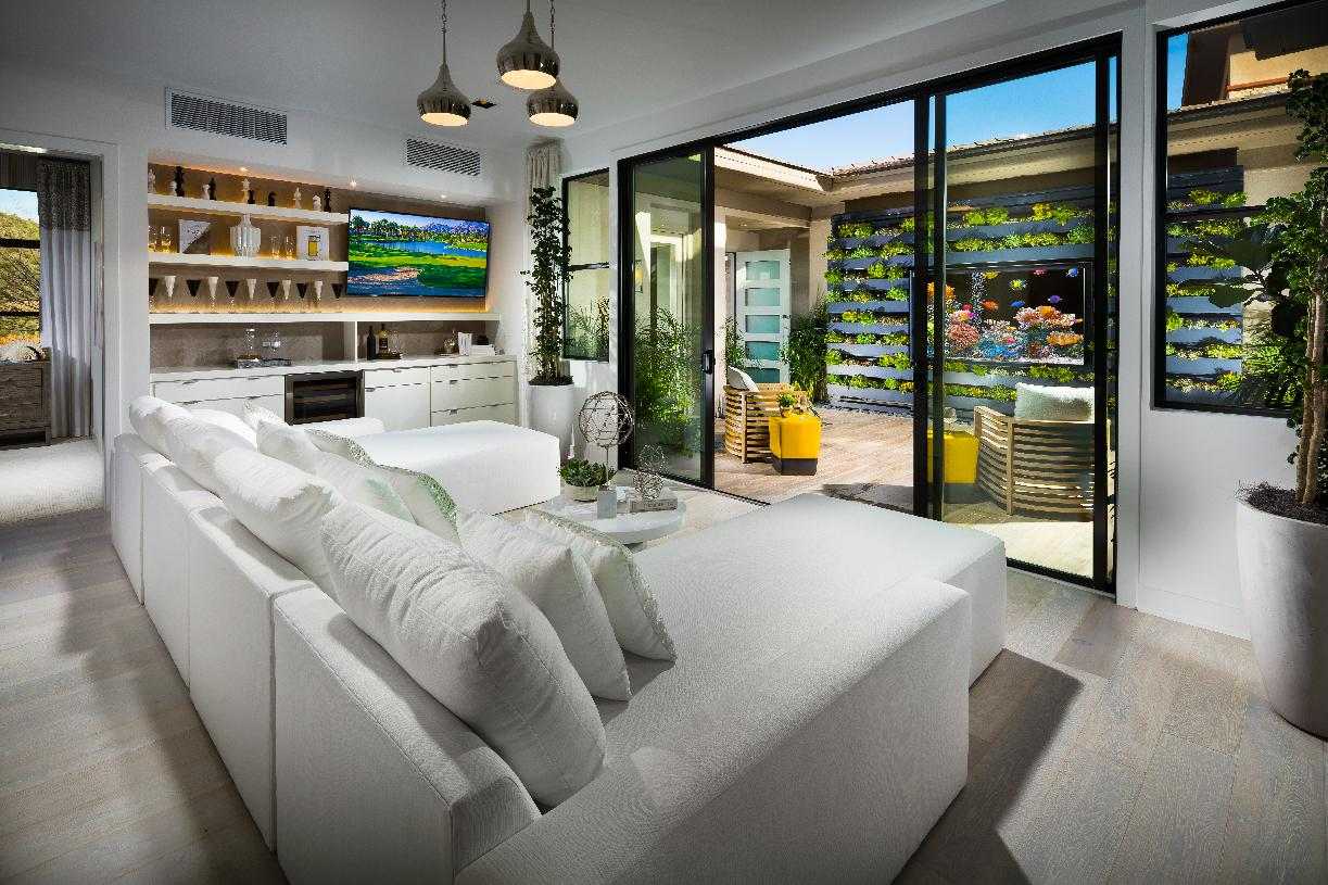 Bonus room with bright sliding glass door access to the private courtyard