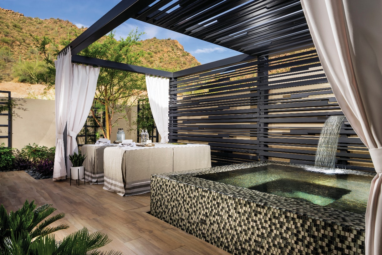 The primary bedroom suite provides direct access to a private spa-like patio