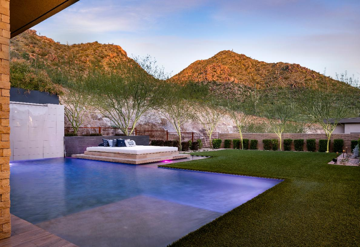 Resort-style backyard with panoramic mountain views