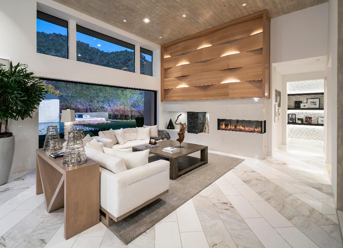 Beautiful great room with custom ceiling treatment and linear fireplace