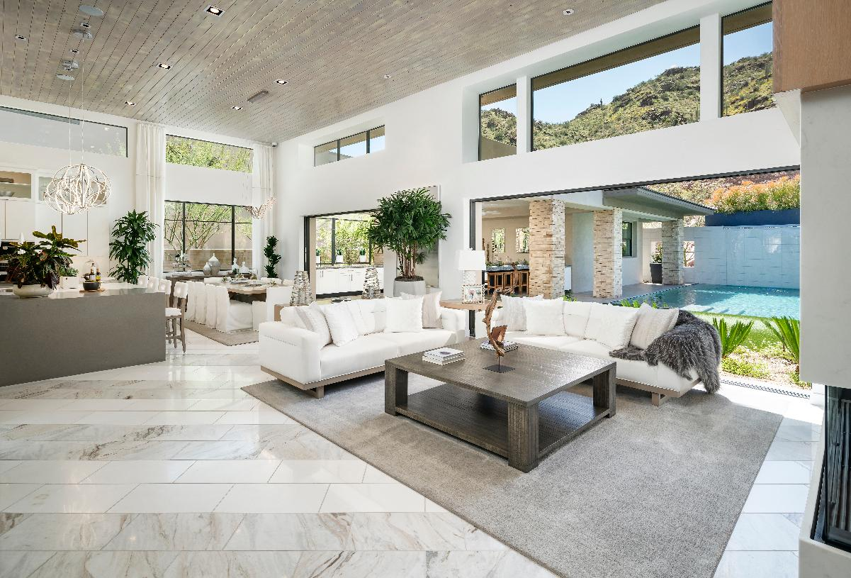 Large great room flows seamlessly to outdoor living spaces