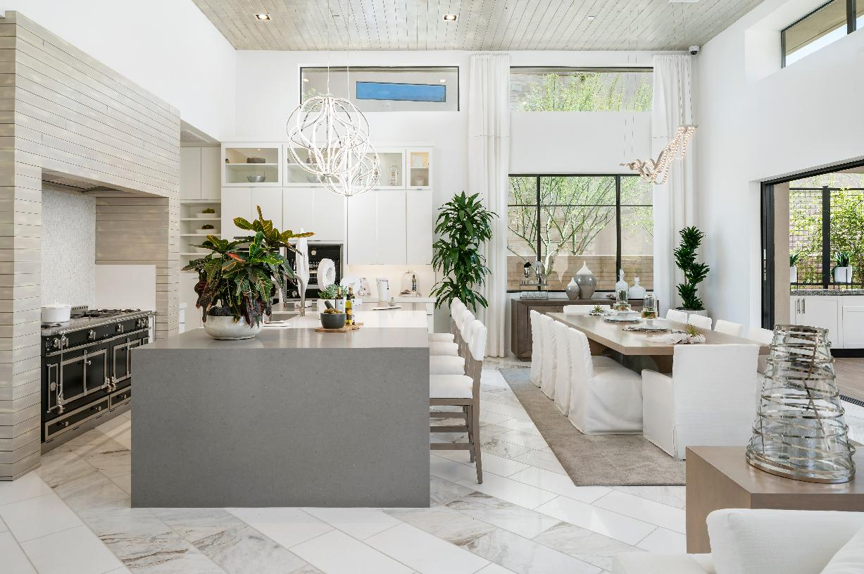 Gourmet kitchen featuring a large center island and breakfast bar