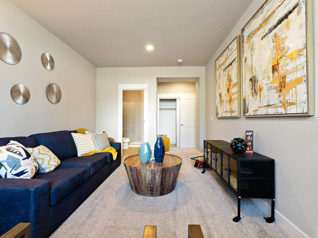 Flex space on the first floor is ideal for a guest suite or a bonus room