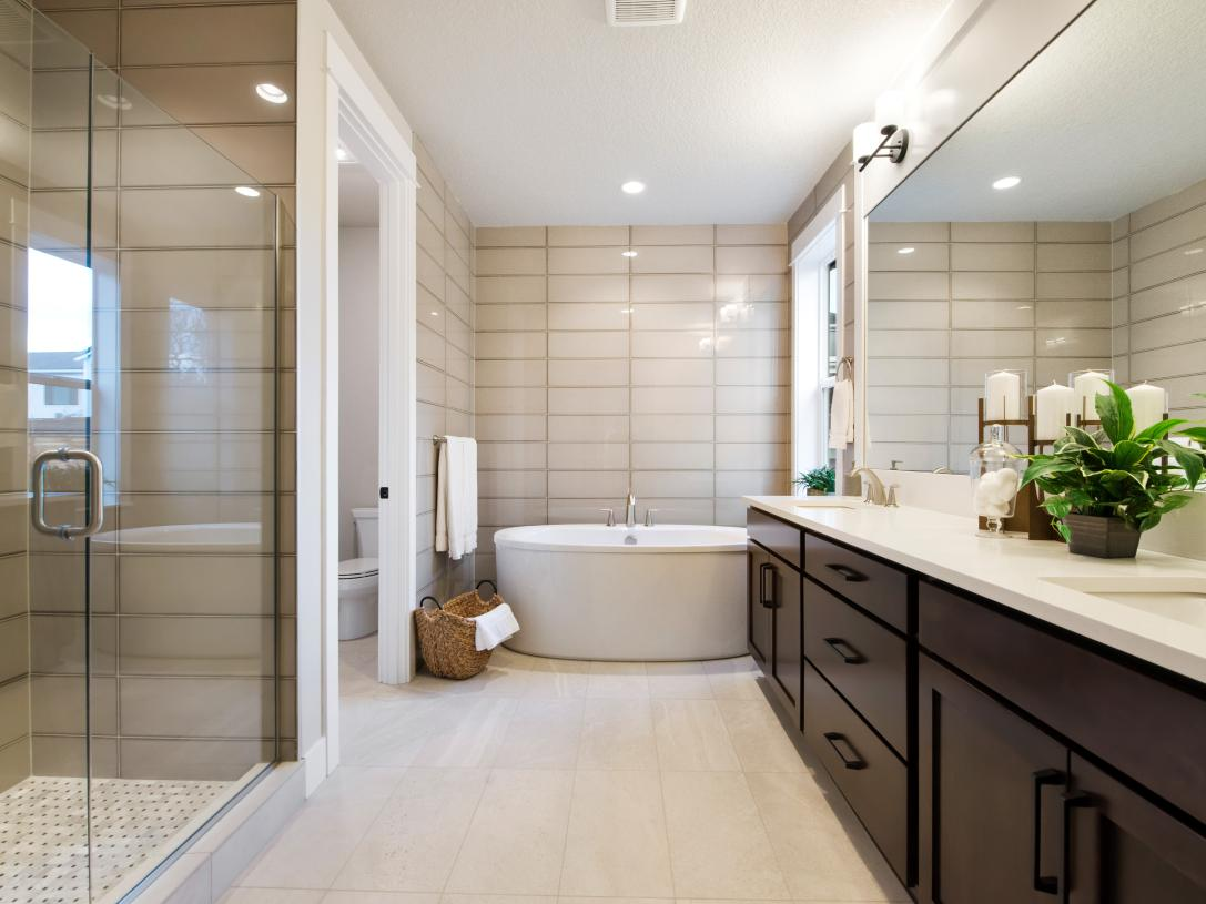 Luxe primary bath features walk-in shower and double vanity