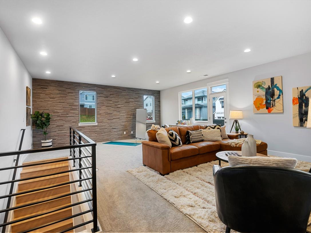 Huge upstairs loft space with warm wood accent wall