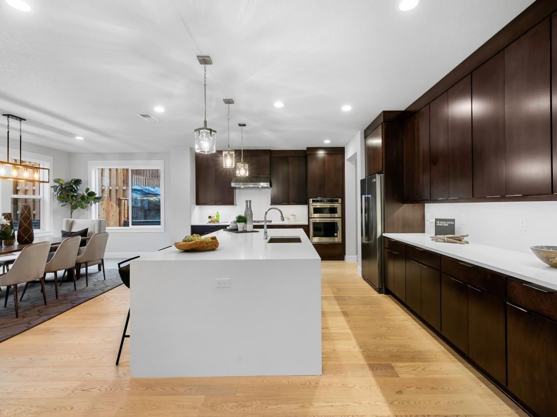 Spacious and bright kitchen with white quartz countertops