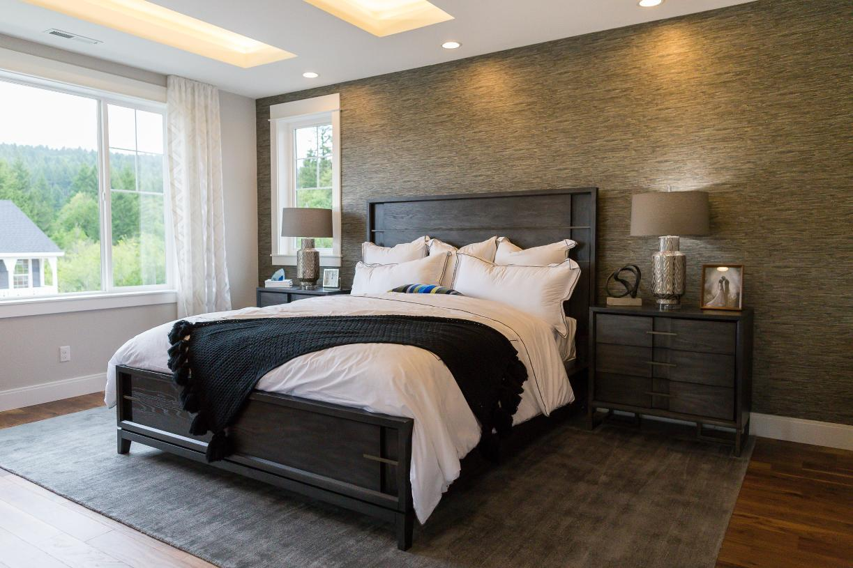 Primary bedroom suite with striking ceiling detail