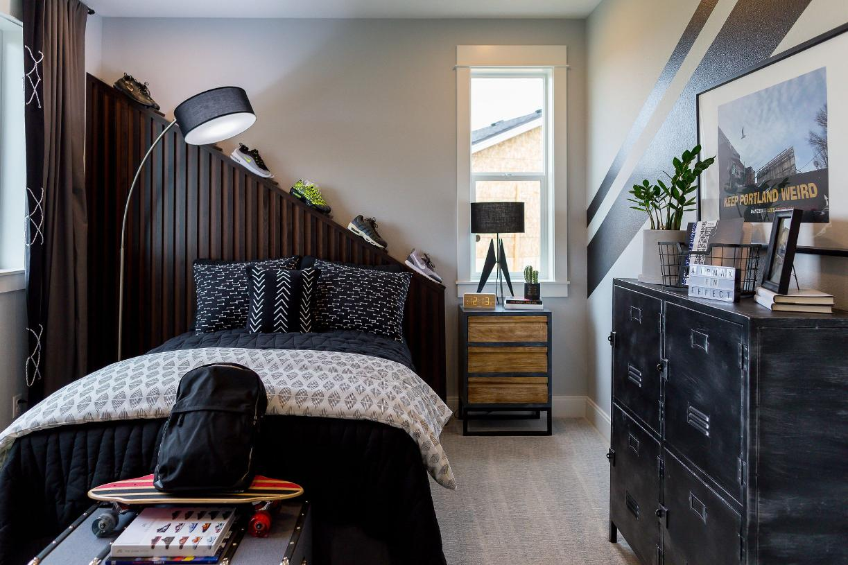 Secondary bedroom with custom built-in cabinetry wall
