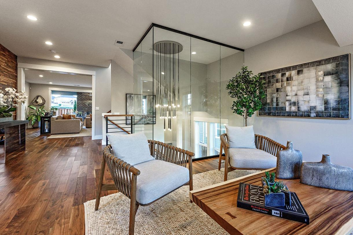 Dramatic glass wall is a centerpiece to the open-concept floor plan