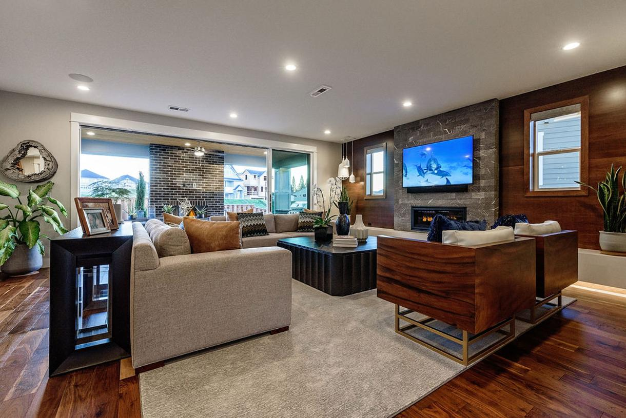 """Spacious great room with 42"""" linear fireplace and floating ledge"""