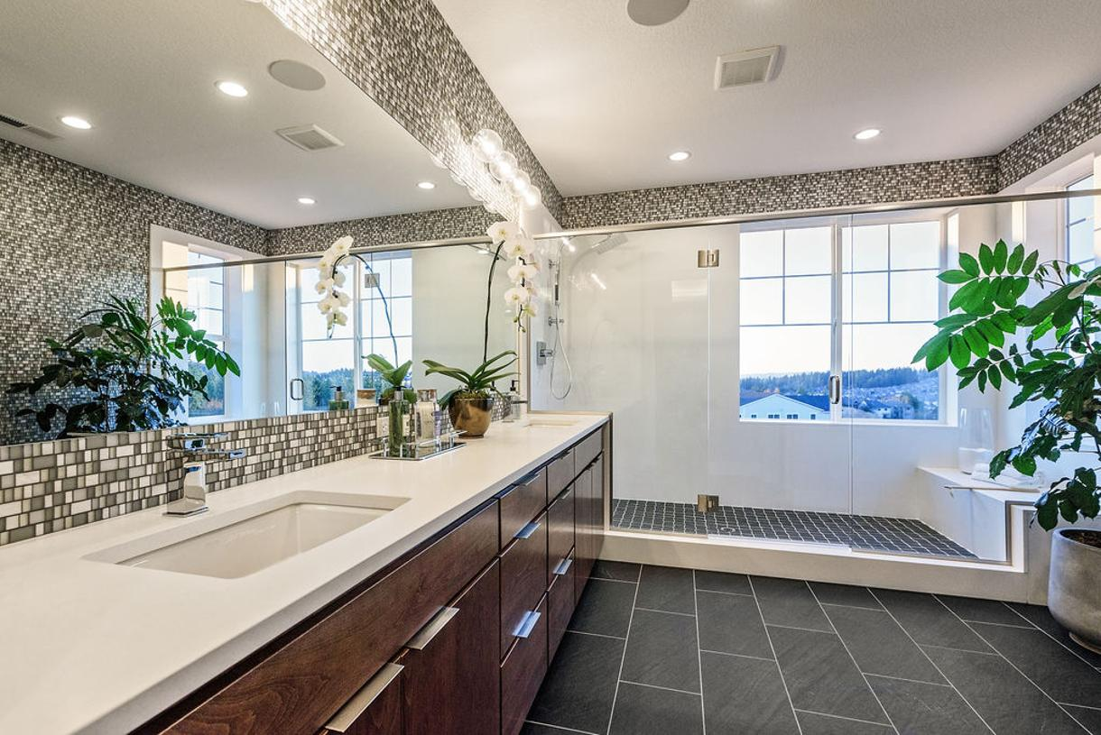 Primary bath with an extended shower and a rain shower head