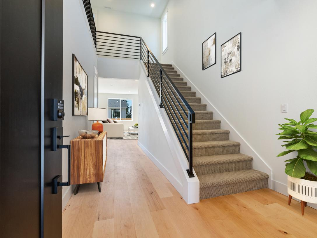 Entry foyer with contemporary metal stair railing
