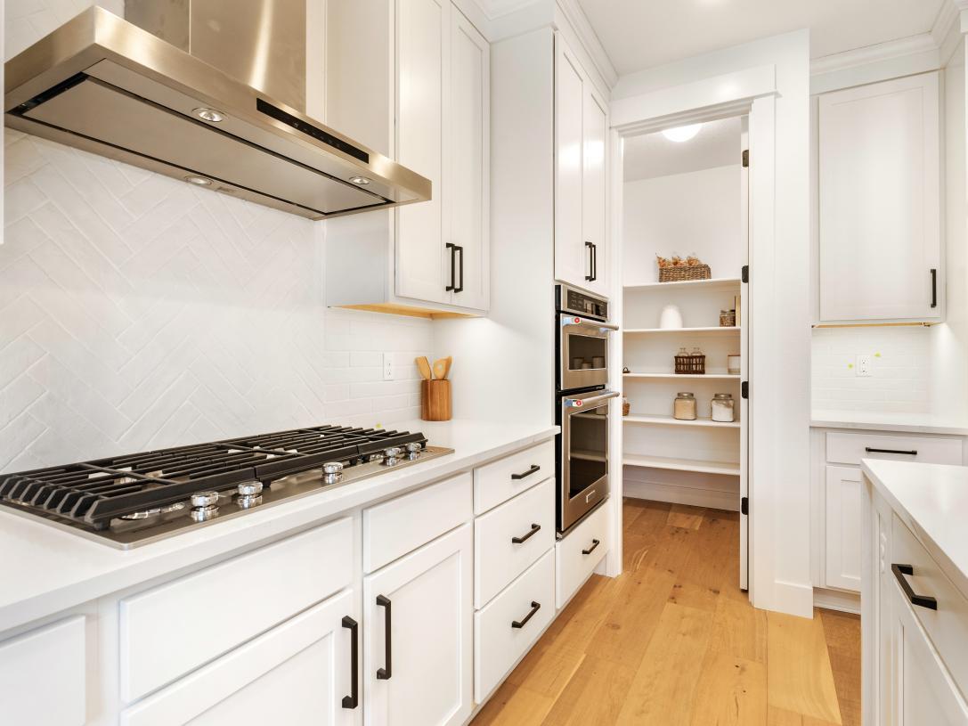 Convenient walk-in pantry adjacent to kitchen