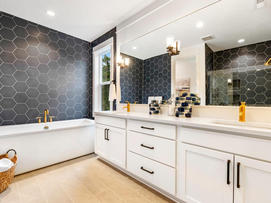 Dual sink vanity and free-standing tub
