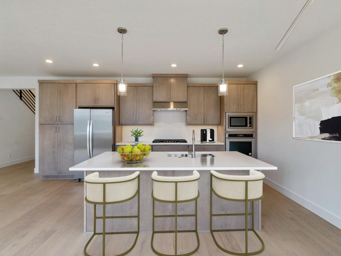 Kitchen with island seating for three