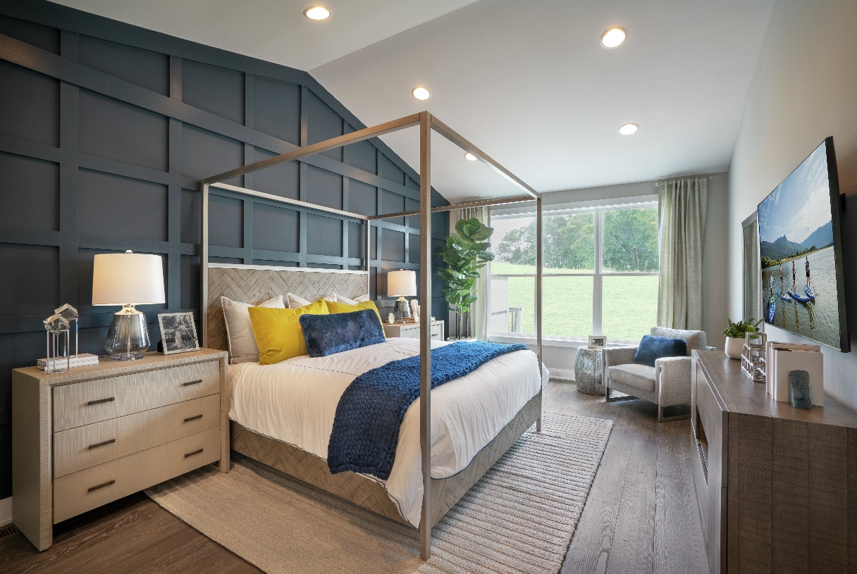 First-floor primary bedroom suite with cathedral ceiling, walk-in closets, and bathroom