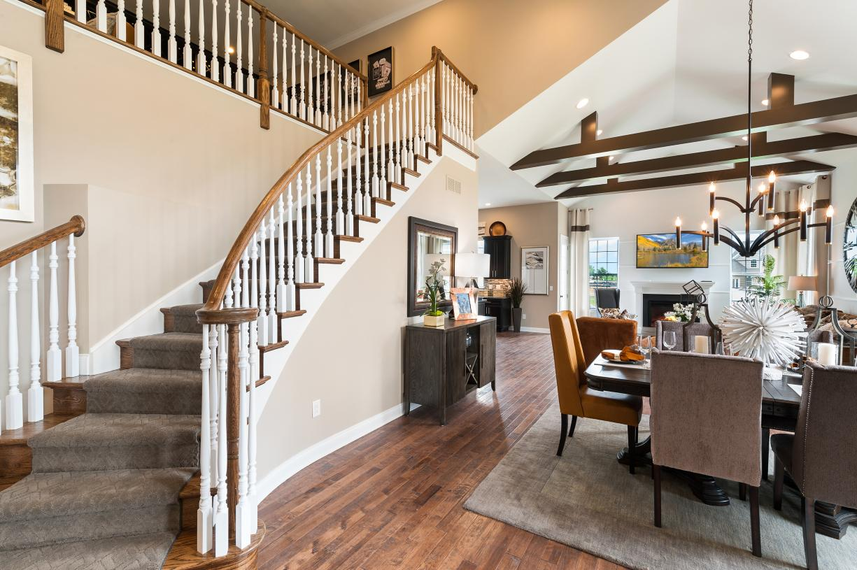 Representative photo - Foyer with vaulted ceiling leads to dining room and great room beyond