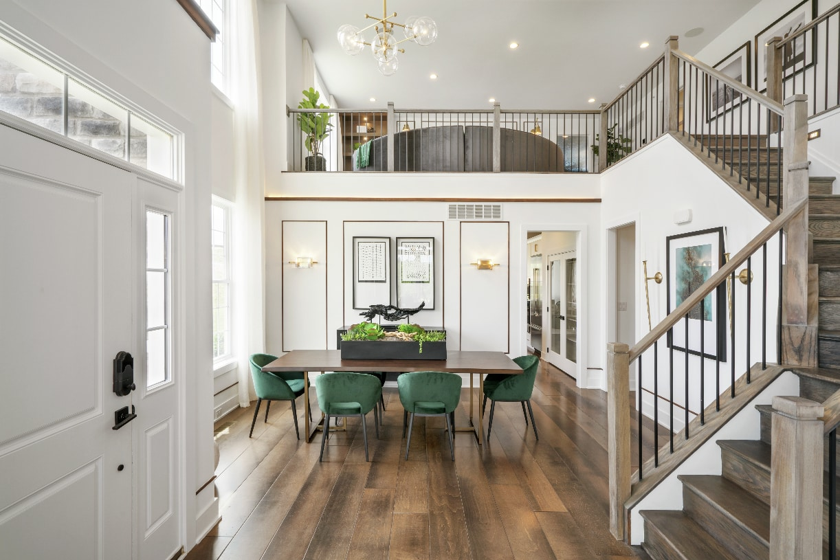 Inviting foyer with turned staircase