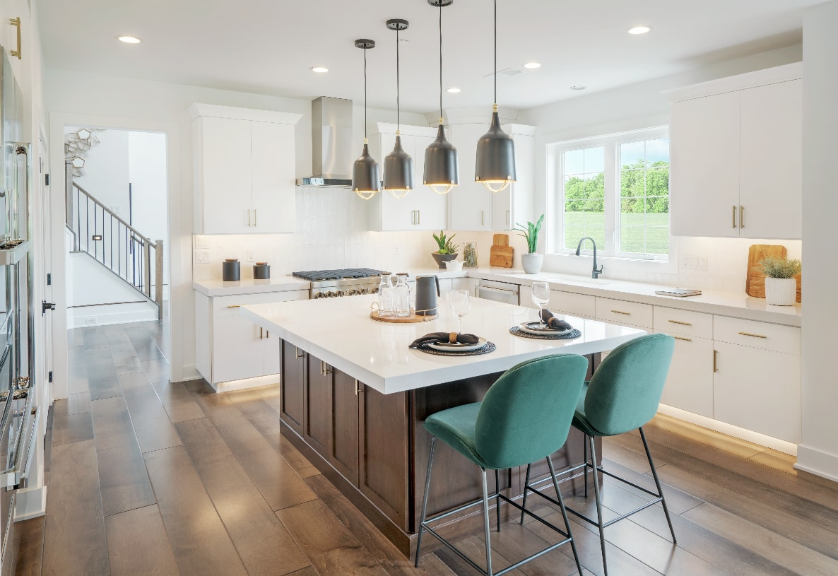 Kitchen features a large center island with seating