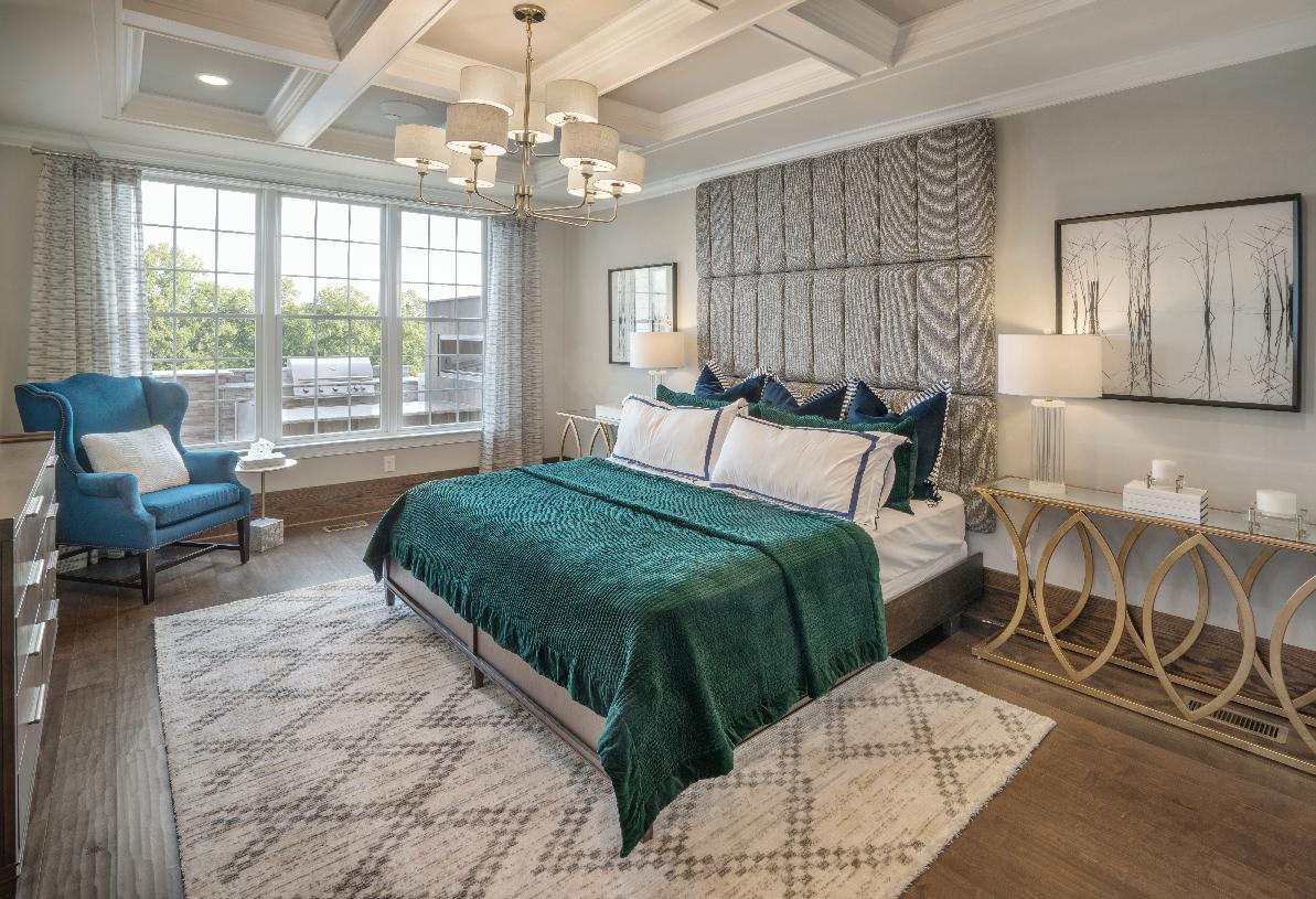 First-floor primary bedroom suite with spacious closets