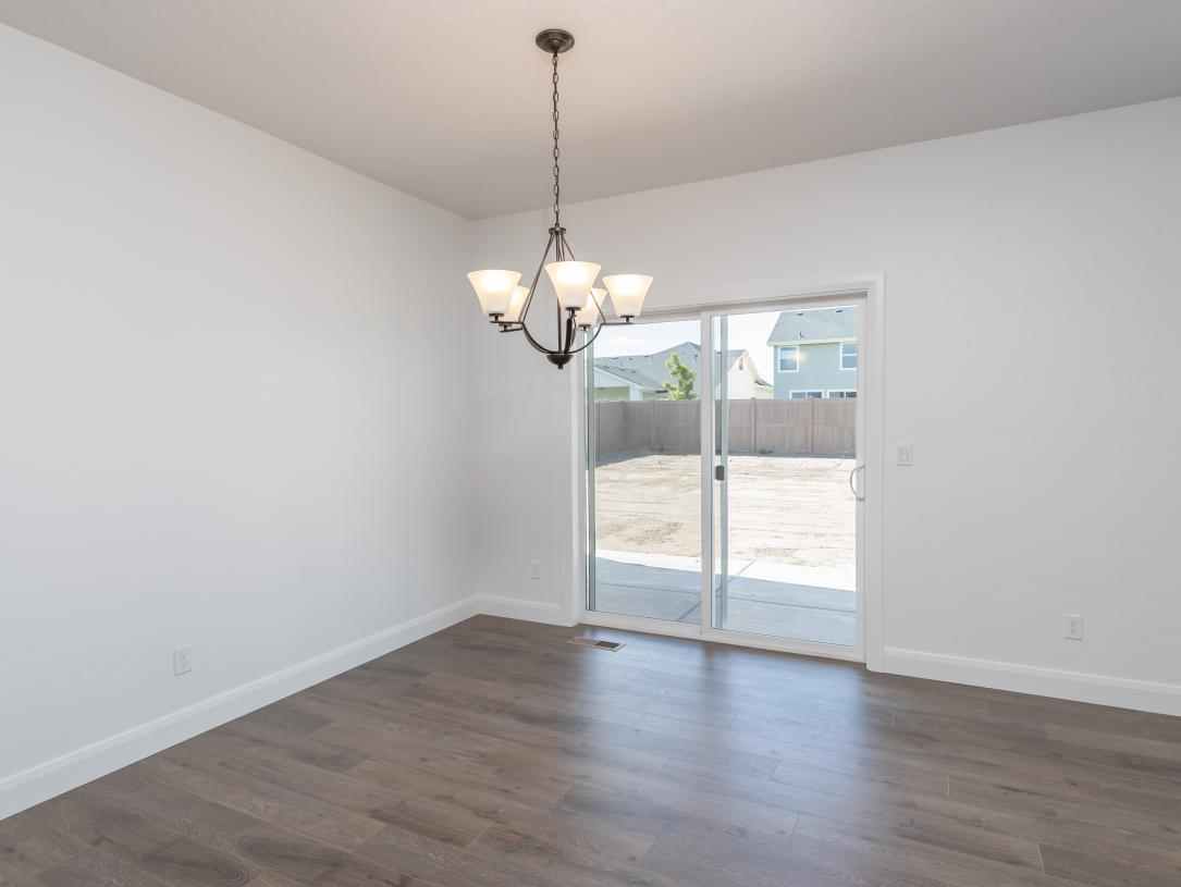 Open dining space and sliding door to covered patio