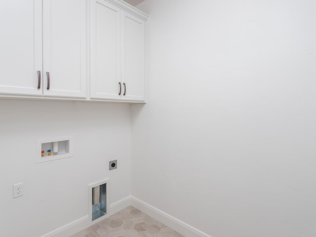 Laundry room with spacious upper cabinets