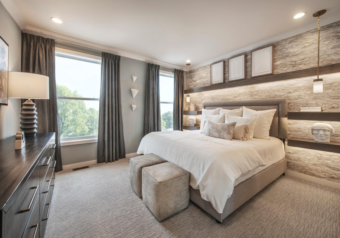 Secondary bedrooms feature roomy walk-in closets