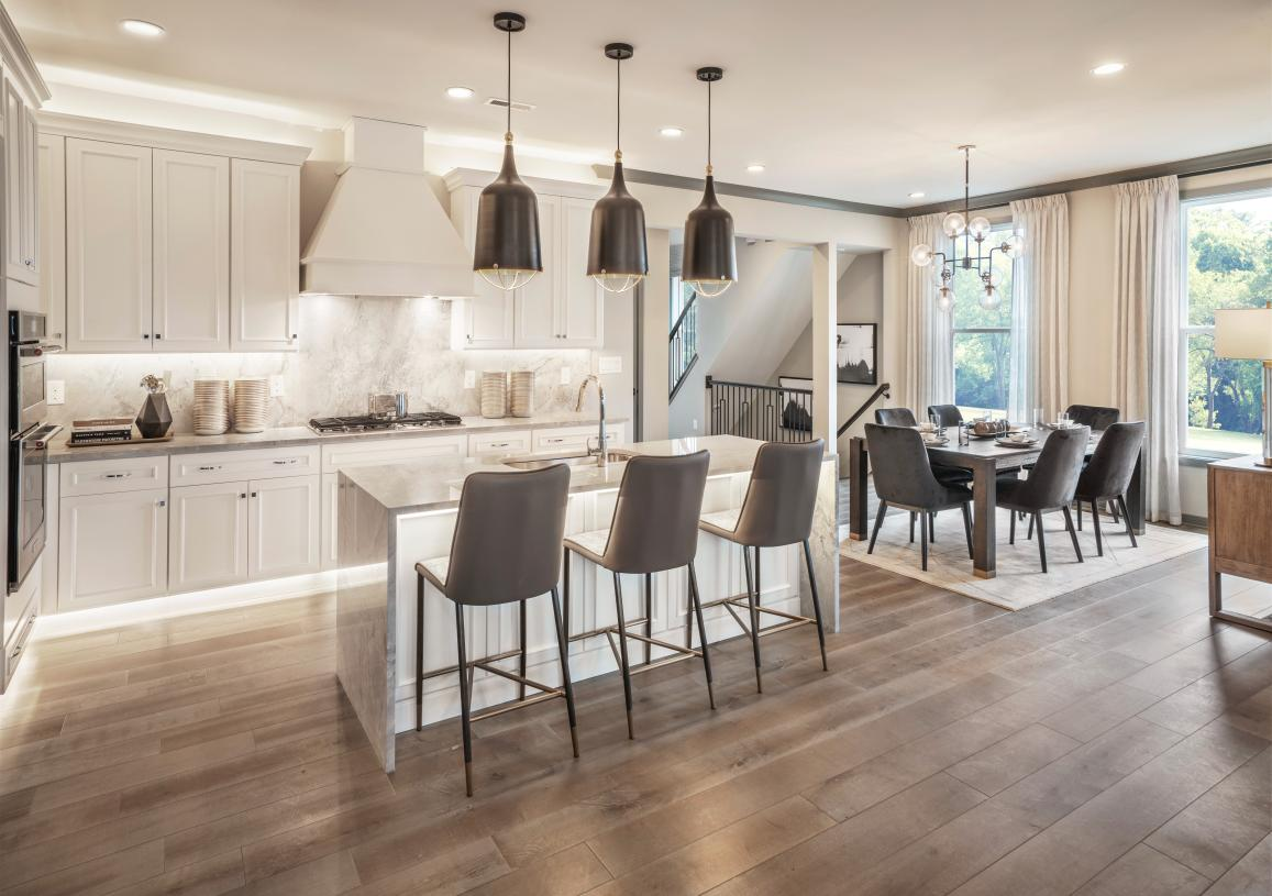 Well-equipped kitchen overlooks a bright casual dining area