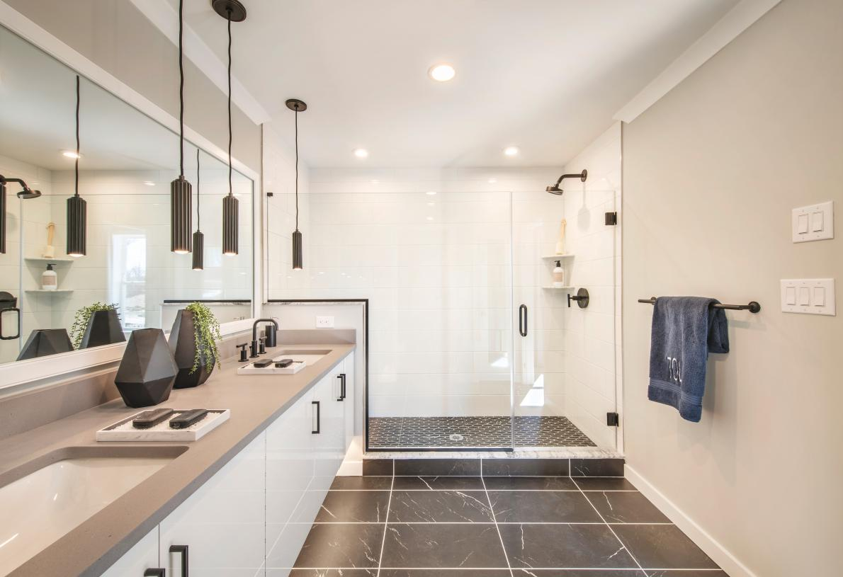 Primary bath with dual-sink vanity, large luxe shower, and private water closet