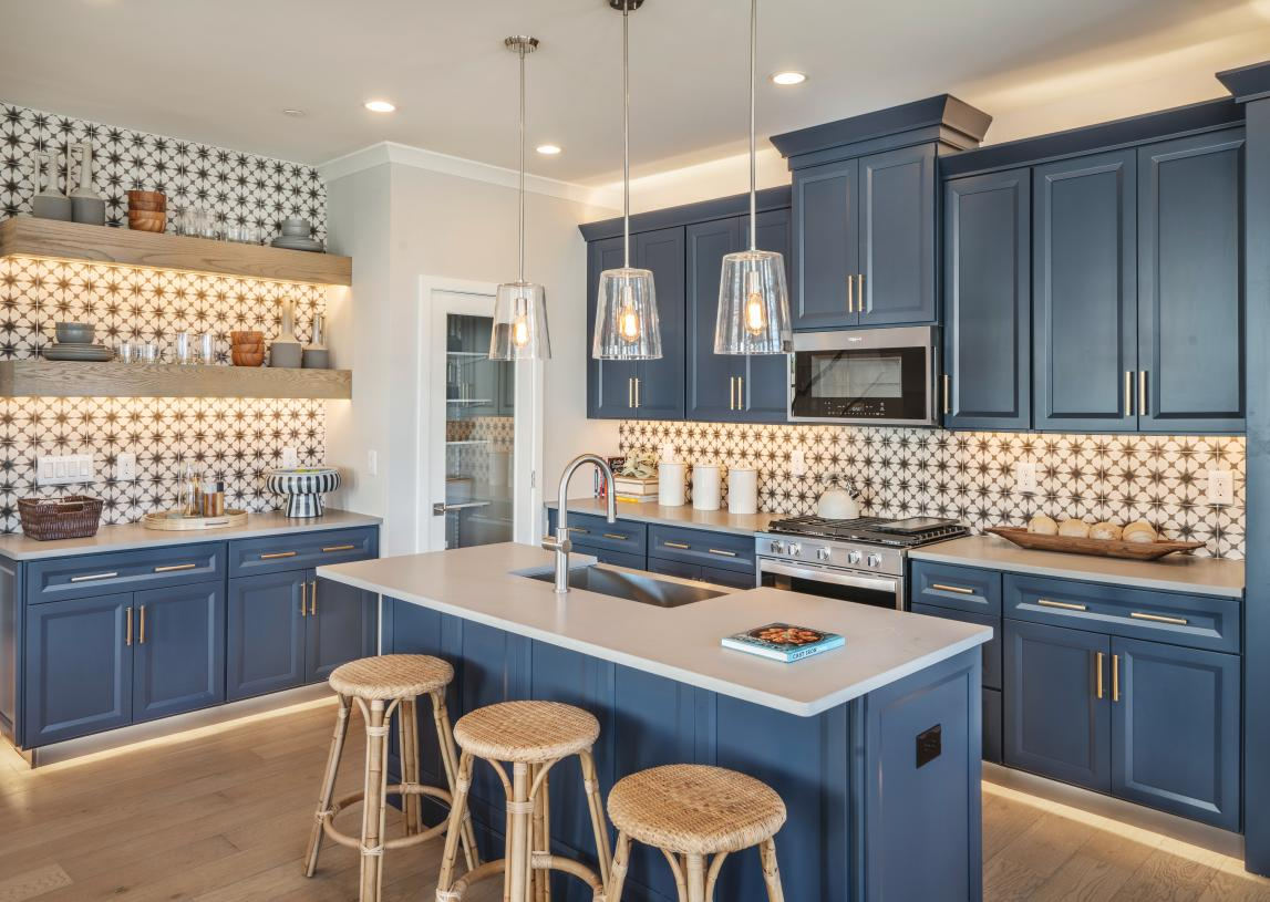 Kitchen is equipped with a large center island and sizable walk-in pantry