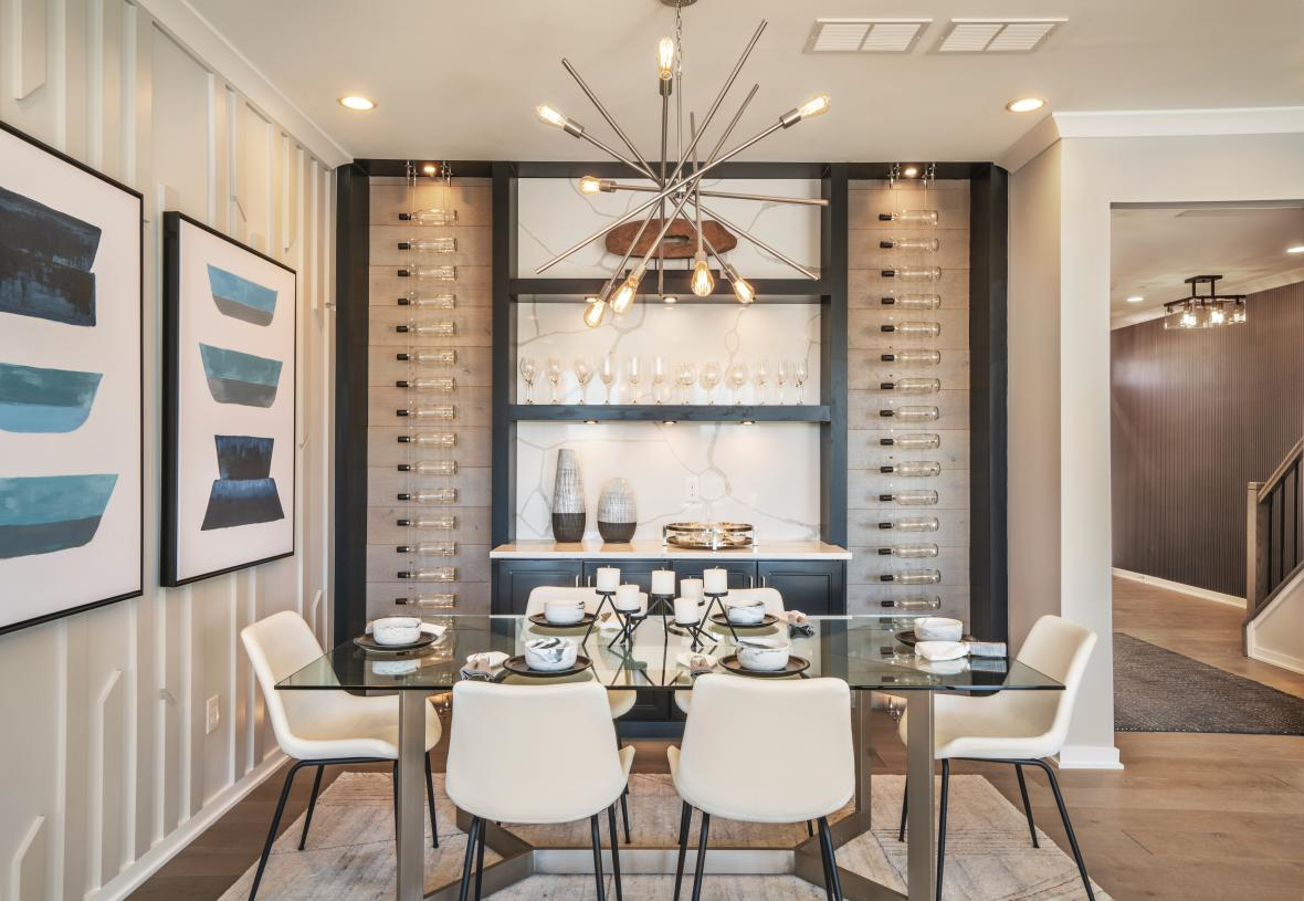Dining area opens to great room and kitchen beyond