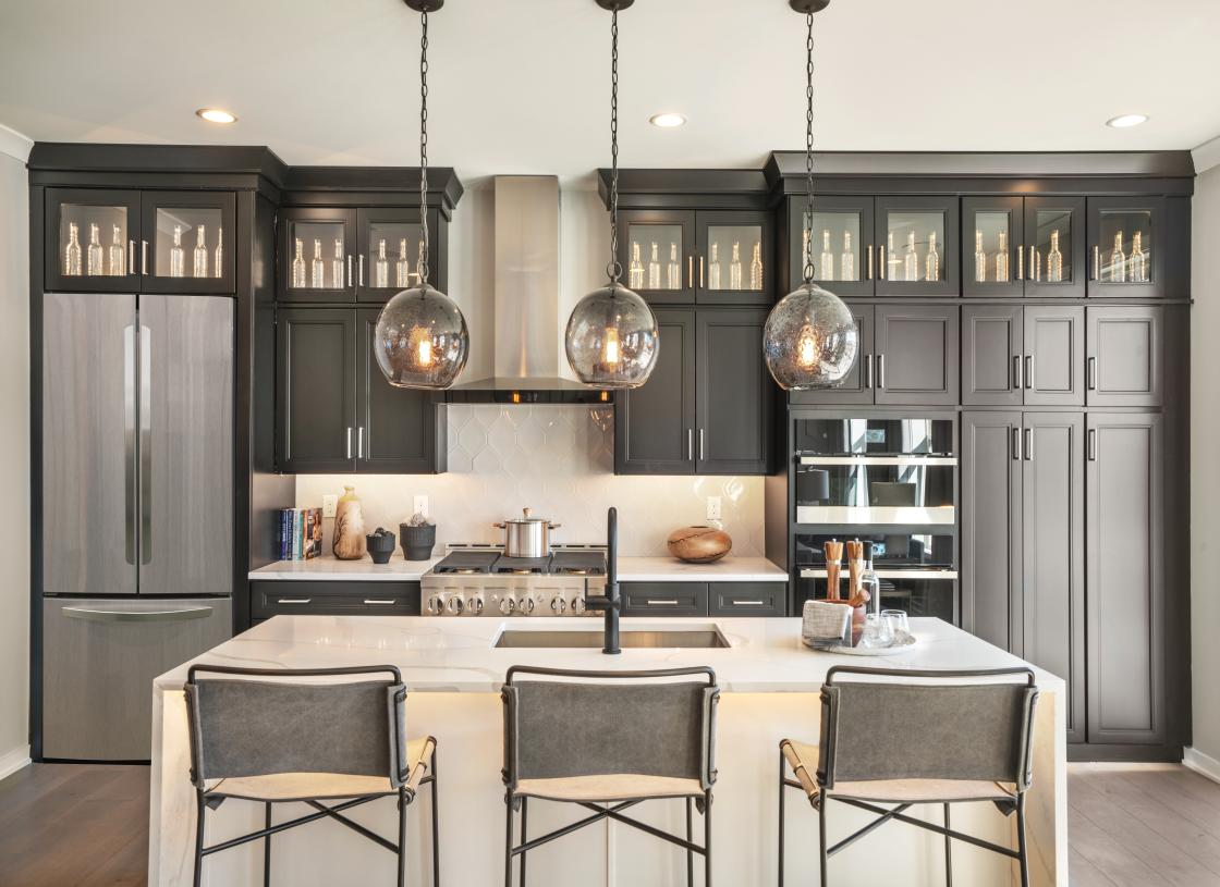 Well-designed kitchen is equipped with a large center island with breakfast bar