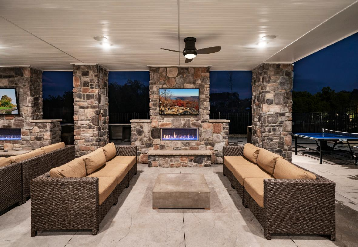 Outdoor amenities include lounge with outdoor fireplaces and ping pong tables