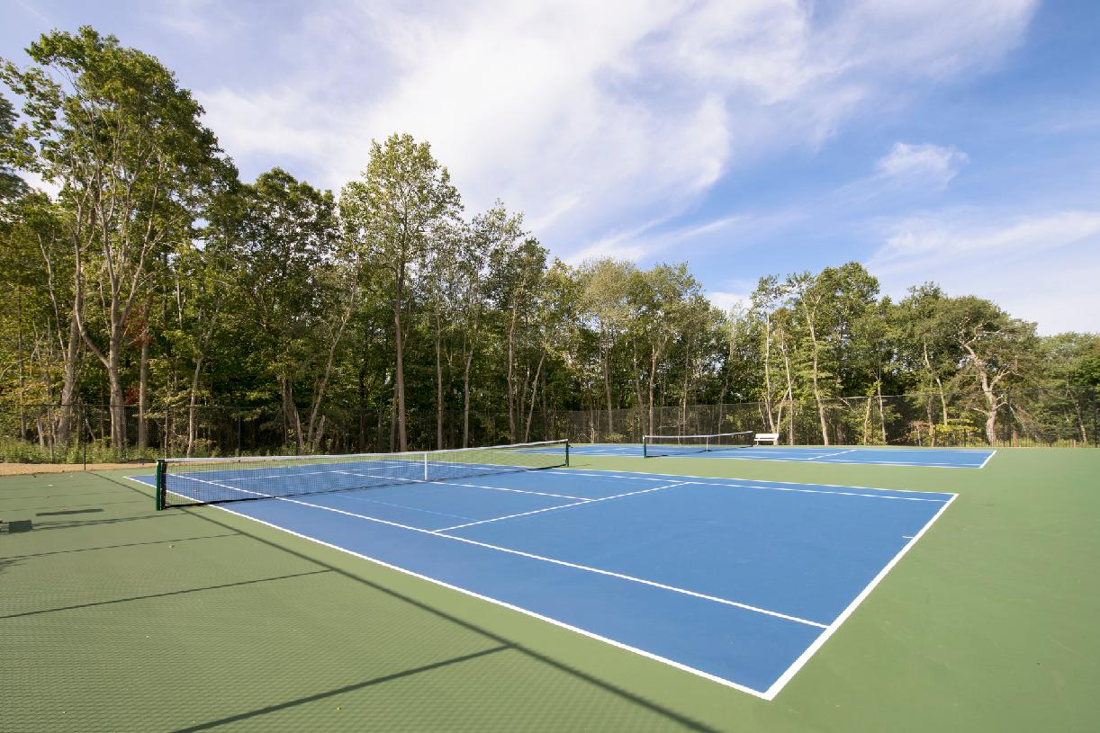 Challenge your neighbors to a game of tennis or basketball courts