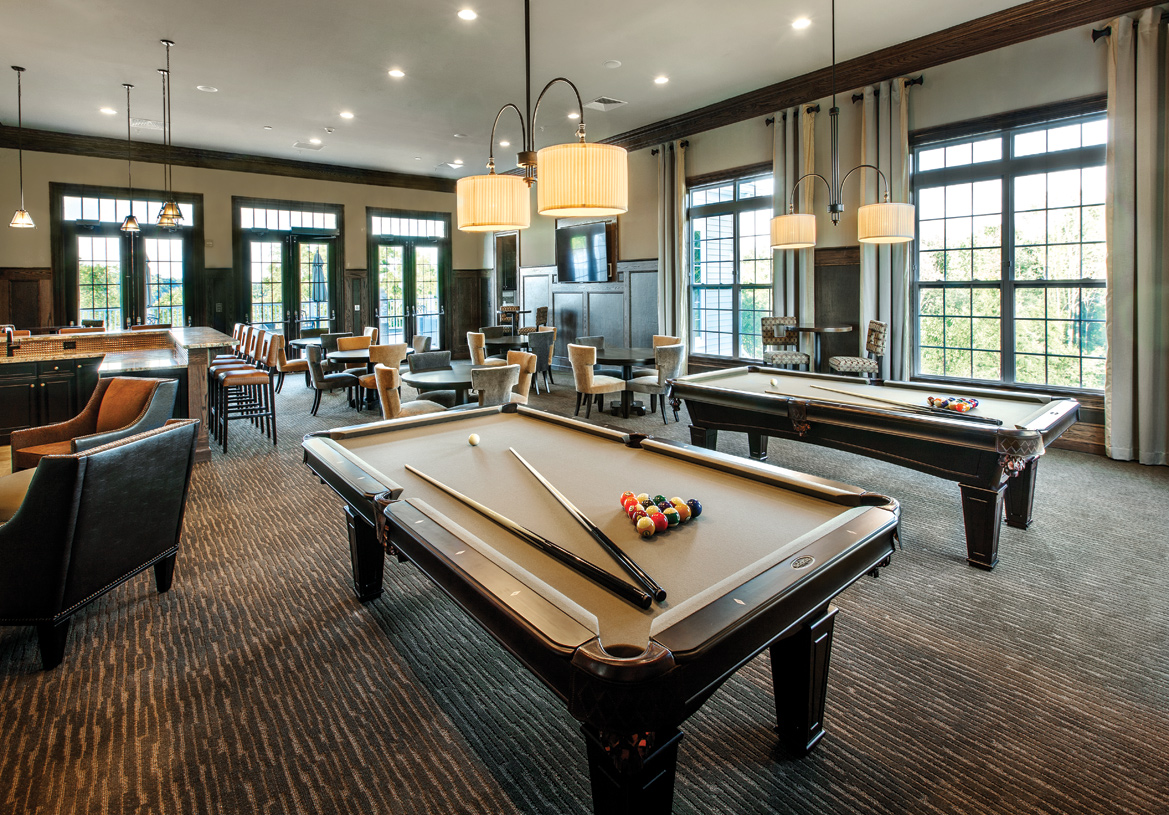 Enjoy billiards or lounge at the bar with friends