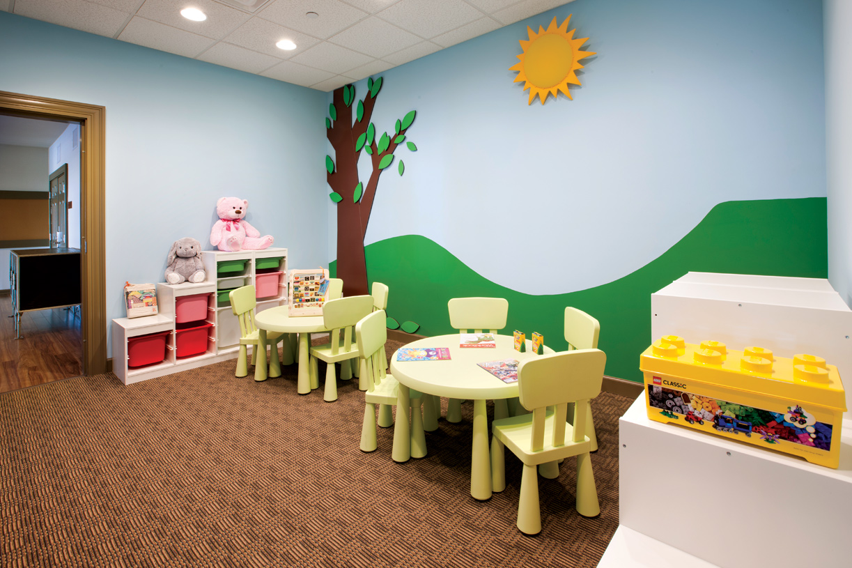 Kids playroom adjacent to the fitness areas