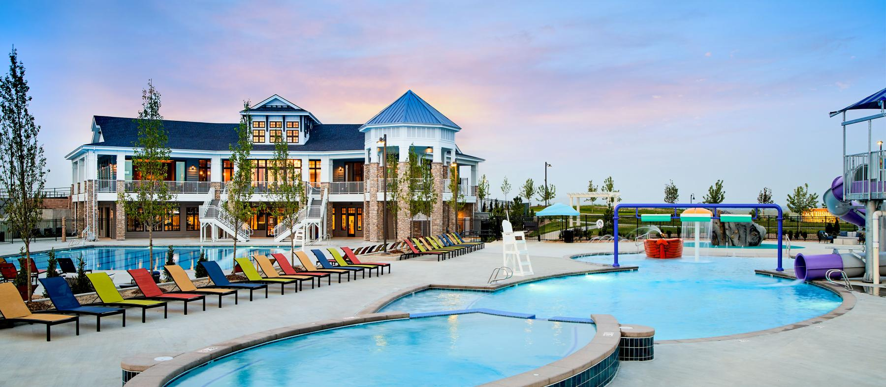 Splash pad, water slide, and lap pool at The Lighthouse amenity center