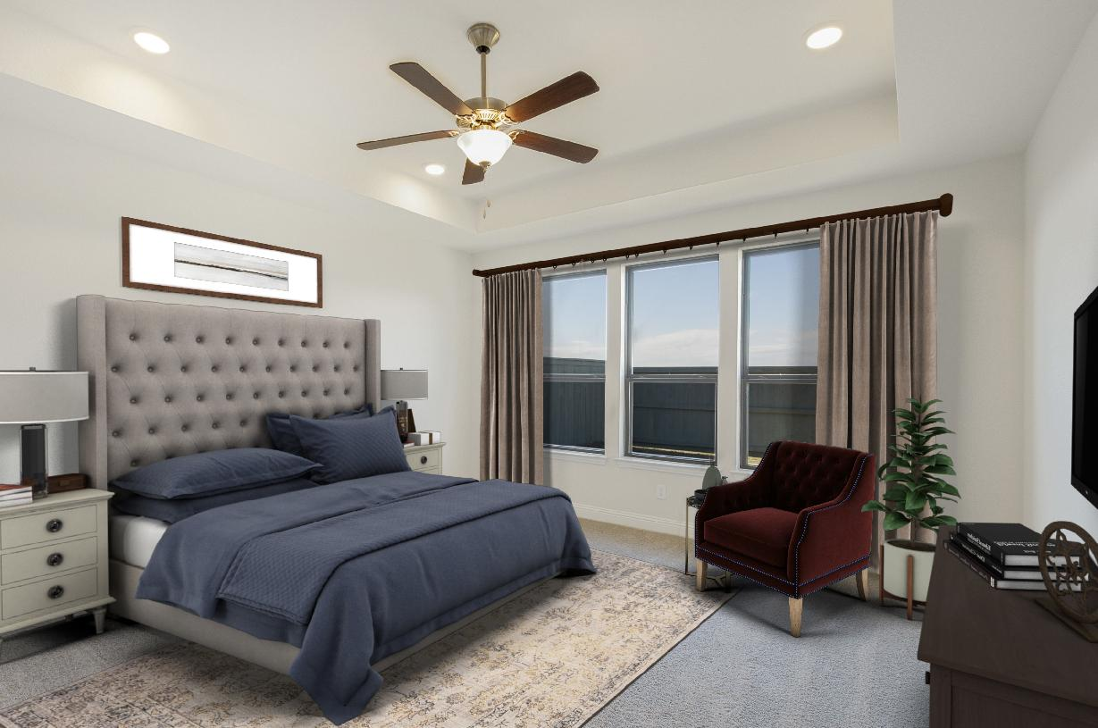 Primary bedroom suite is highlighted by a tray ceiling