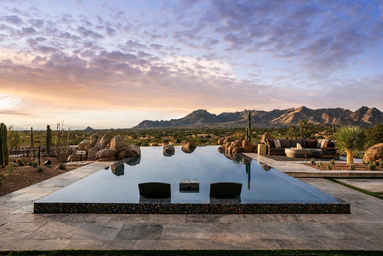 Award-winning, resort-style backyard with mountain views