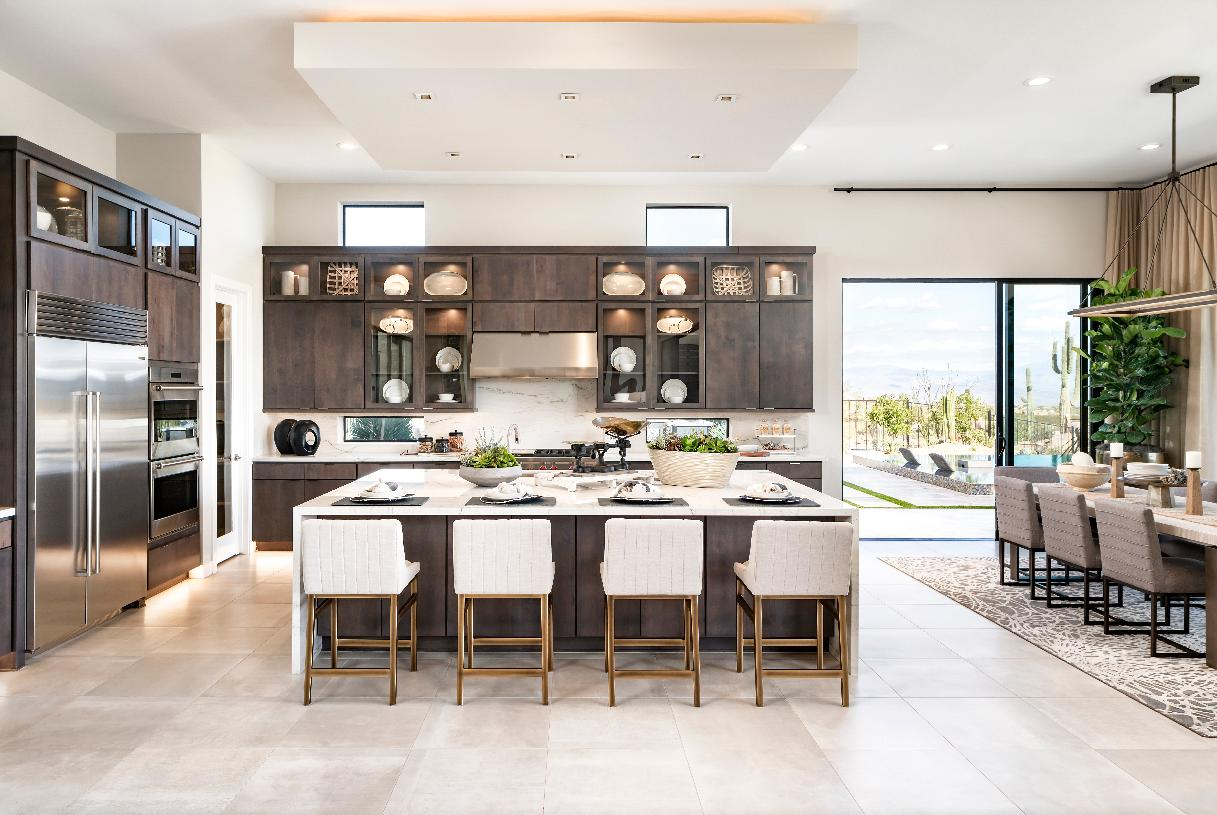 Gourmet kitchen and dining room with seamless access to outdoor living spaces