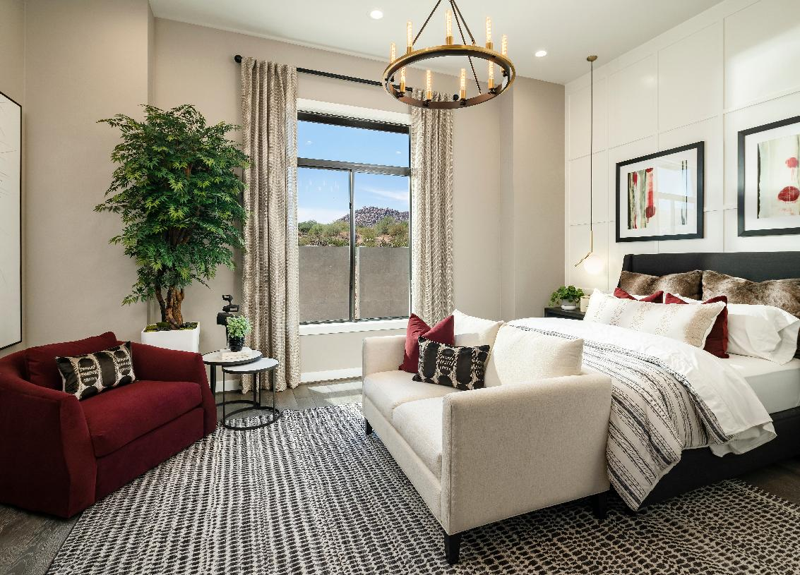 Secondary bedroom with a sitting area